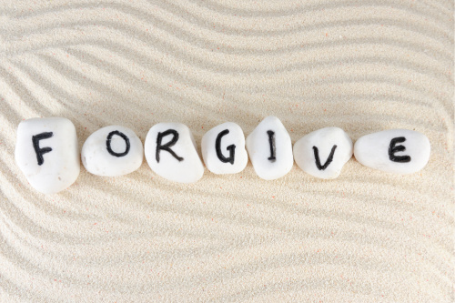 Forgive stones representing a reminder that forgiveness works.