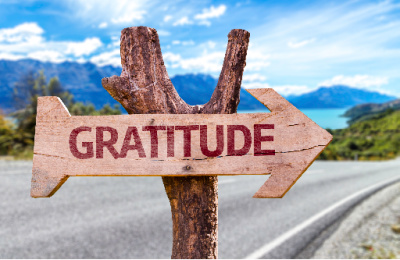 Create gratitude lists as a way to find direction.  Gratitude written out on an arrow pointing the way on the road.