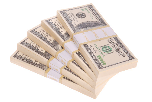 A positive affirmation can encourage the ability to generate money as represented by these $100 bills.