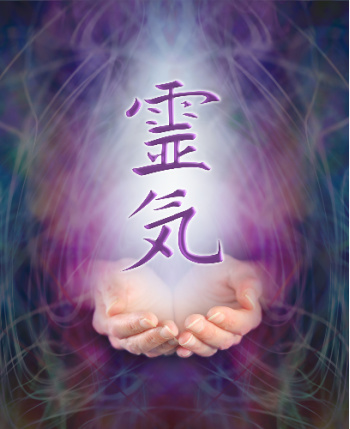 Japanese characters above illuminated hands.  This photo represents Reiki spiritual healing.