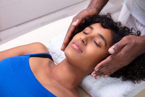 Person deeply relaxing as she receives Reiki.  Sekhem Seichem Reiki also lays the groundwork to encourage deep relaxation often having the ability to go deeper if needed.
