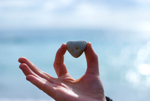 A heart shaped stone representing the love that is required for a good/peace rendering forgiveness prayer.