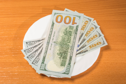 The tithing definition means donating 1/10th of your earnings to your spiritual organization.  However, if needed, you can donate the funds that work for you as indicated by these $100 notes.