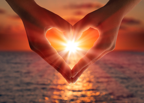 If you are tithing while in debt, you will eventually receive something in return.  Here, a heart around a sunset represents receiving after tithing your time, money, or other heartfelt service.