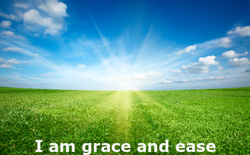 Prosperity Affirmation against the background of the sun shining on the grass.  The affirmation is