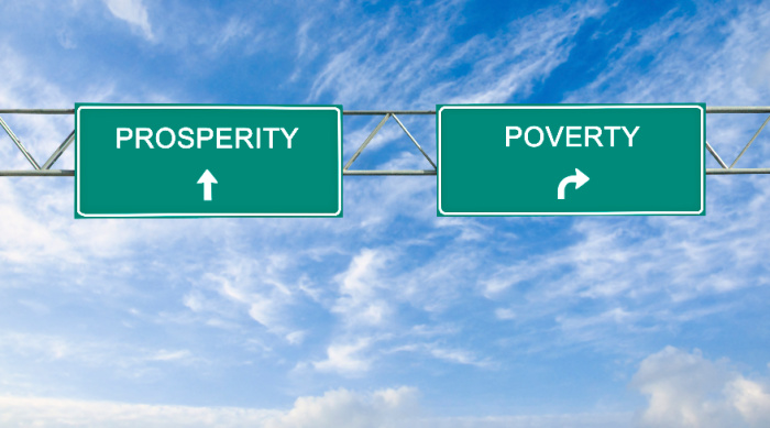 A prosperity consciousness direction sign pointing to a prosperity or poverty mentality.