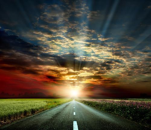 Road into the sunset symbolizing the journey of vibrational energy healing.